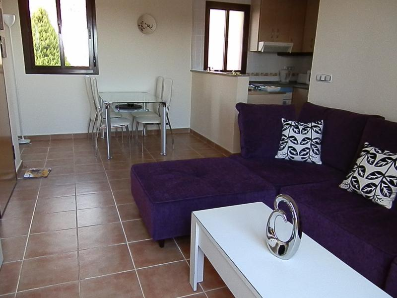 Spacious open plan lounge/ dining room/kitchen area with tv/dvd player