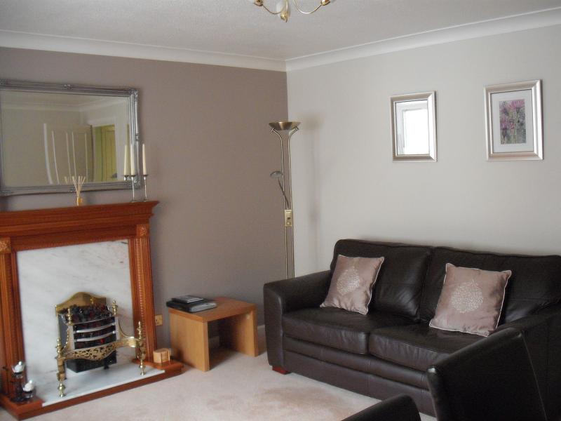 Living Room, with Bed Settee . Extending dinning table with 4 chairs.Coffee table & 2 small tabl