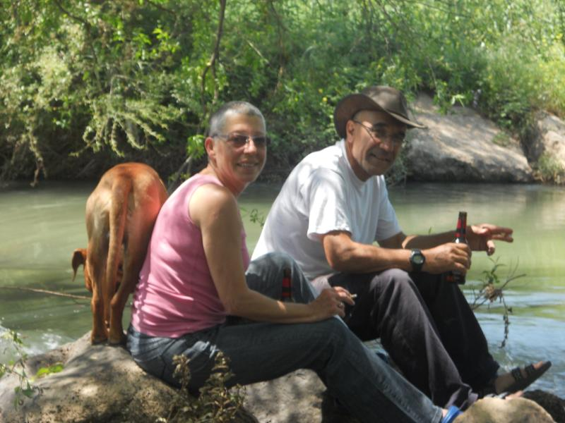 Liora and Michel enjoy the Jordan River