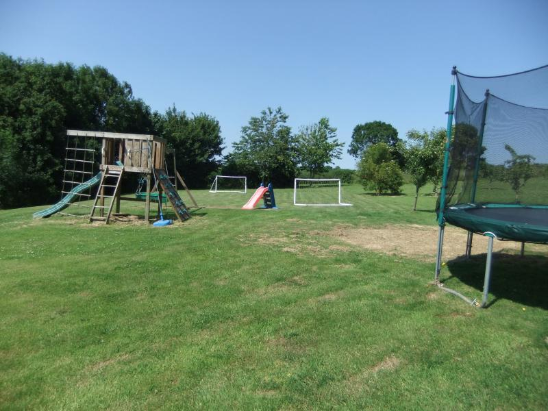 Kids play area on main field with Jungle Gym, trampoline and 5-a-side football goals