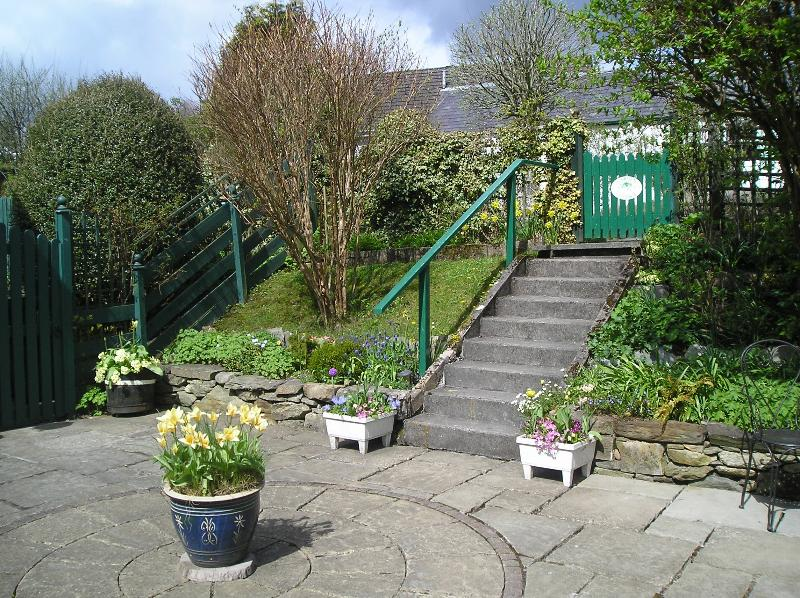 Courtyard with steps to Garden Cottage