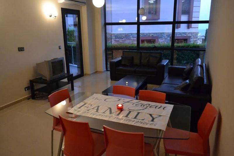 Dining table and living rm, opens onto balcony, floor to roof windows