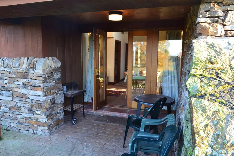 Patio overlooking the Tarn with garden furniture and bbq available.
