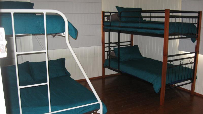Largest bedroom with double and single bunk beds - linen provided