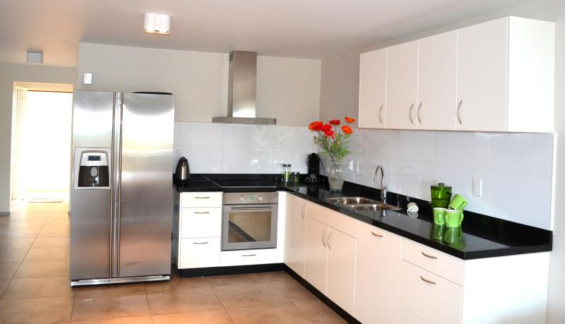 Spacious open kitchen with dishwasher, microwave, toaster etc.