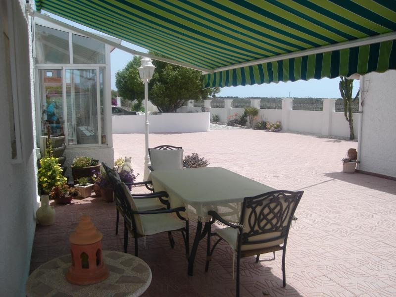 You can relax under your awning in the shade in Summer months.  Nice and private.  Electric awning.