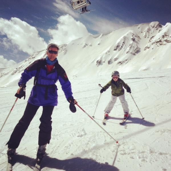 Skiers make there way down from the top lift station at above 2500 metres.