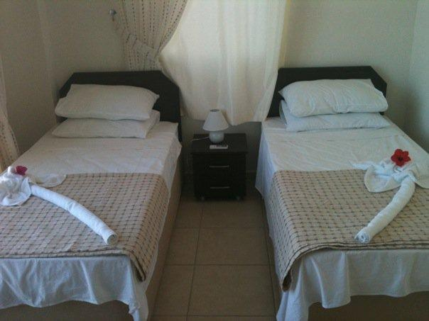 The second bedroom has twin beds and is directly next to the second bathroon