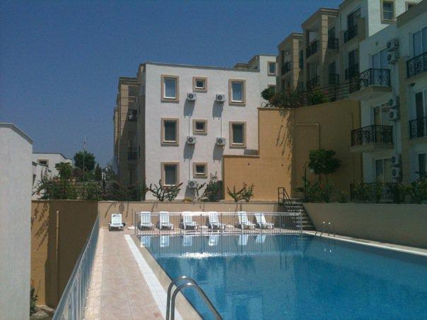 The 1st floor apartment is situated very close to the large pool