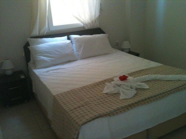 The luxurious main bedroom has a double bed with en-suite bathroom