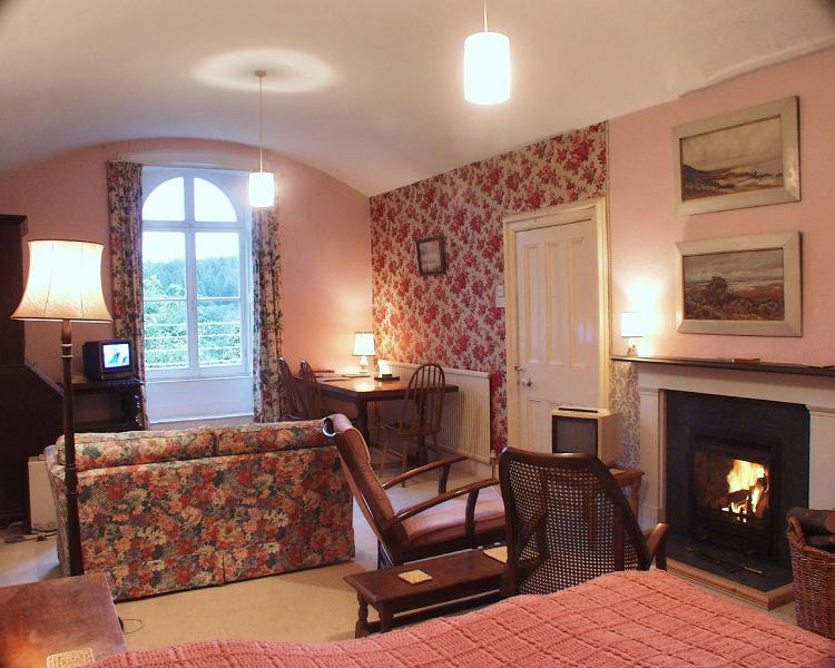 Looking down Flat 3's main room from the sleeping area