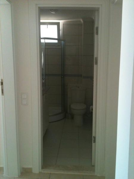 Second bathroom has shower, hand basin and toilet