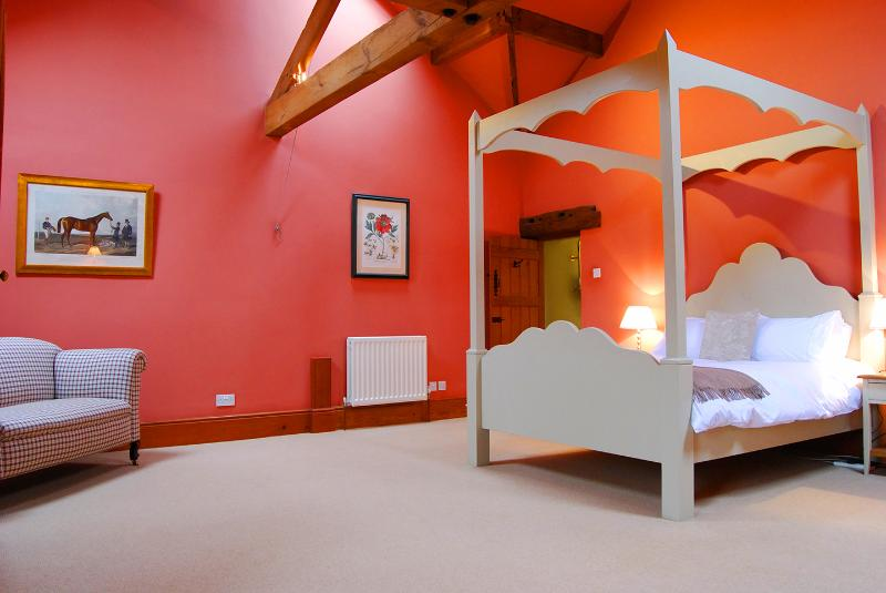 Bedroom with king-size bed and vaulted ceiling