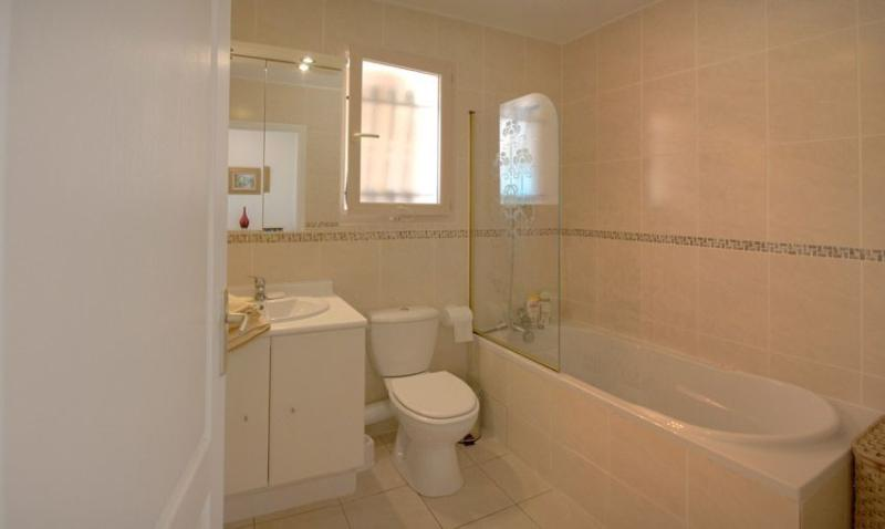 Bathroom, vanity basin and W/C, fully tiled with shower