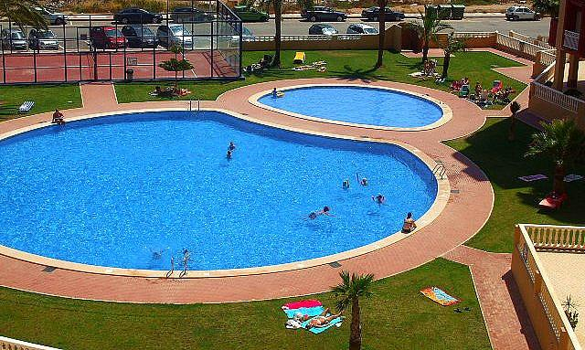 Spacious swimming pool with children's area.