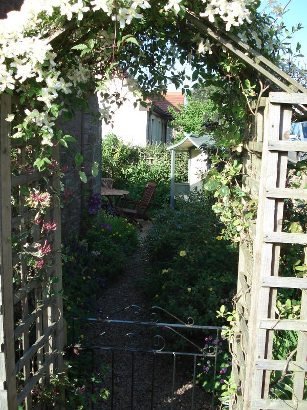The arch to the side and rear garden
