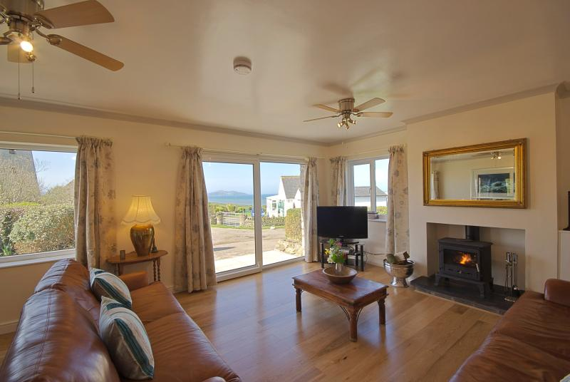 Stunning sitting room with log fire and sea views in Anglesey North Wales