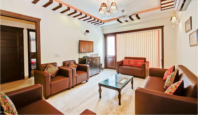 The Beautiful Living Room with Italian Marble Flooring and Sofa Sets and LCD , WIFI , Balcony etc...
