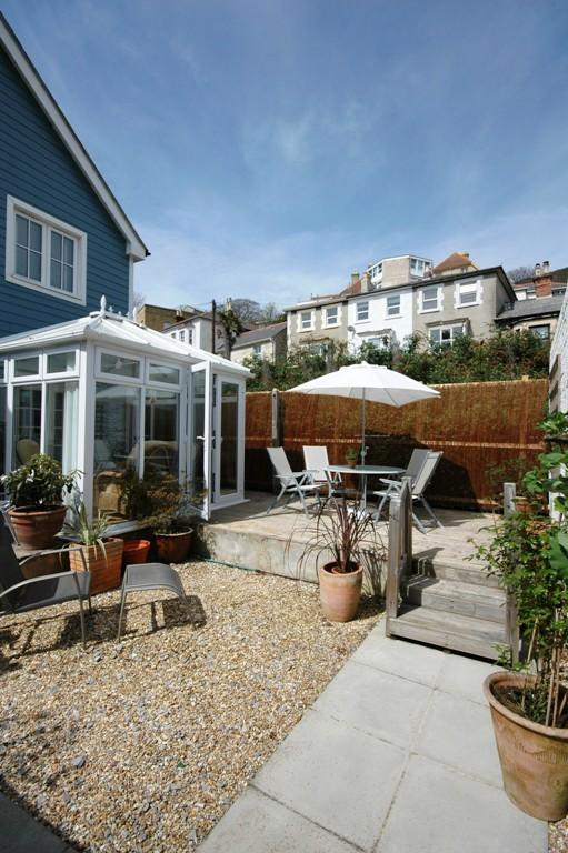 The private garden with conservatory at the back of the property