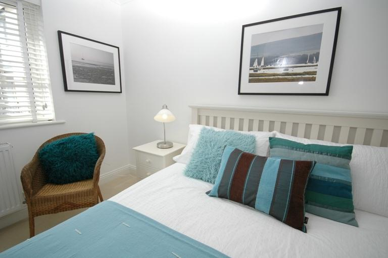 The king room is a large bedroom with views over the court. Lovely late sun