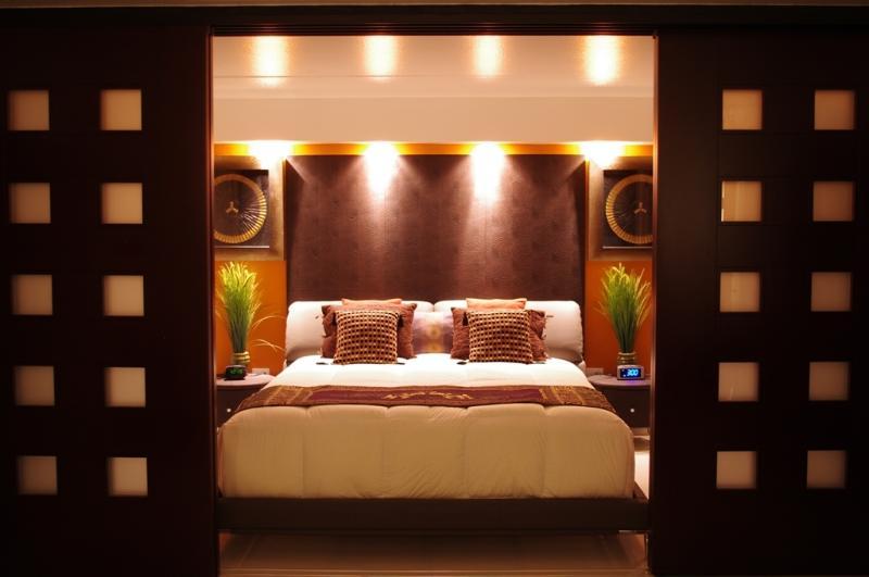 Bedroom1:  SLEEP LIKE ROYALTY Marseille Geniune Leather King Bed, 2 Pisa Geniune Leather Nightstand.