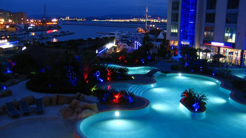 View of Pool at night from balcony