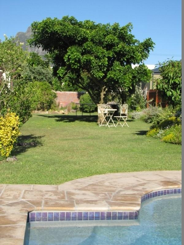Take a dip in the large private pool or have breakfast under the trees