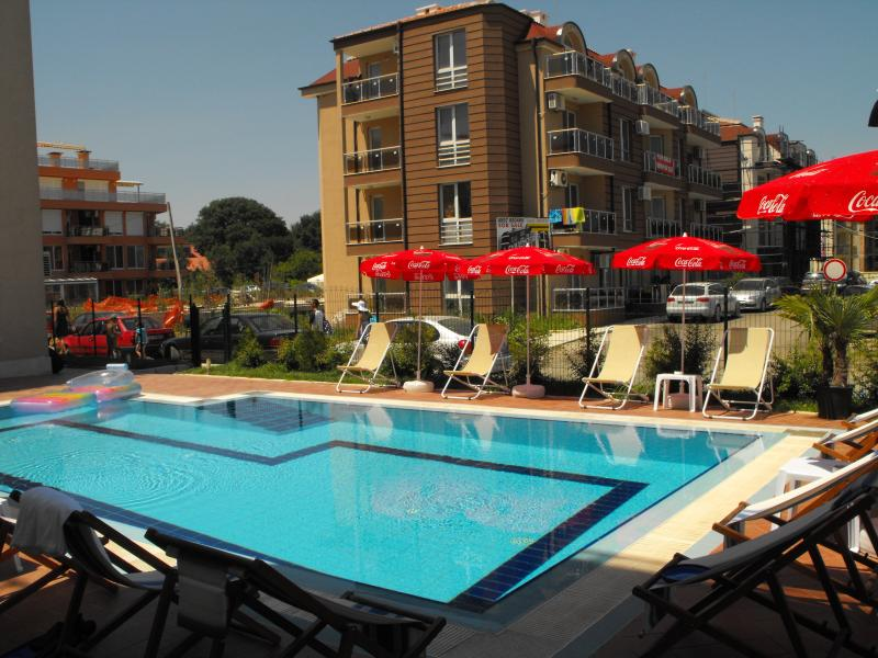 The apartment is on the ground floor with direct access to the outdoor swimming pool.
