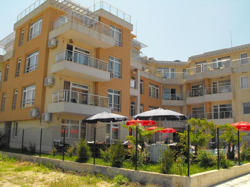 Exclusive apartment complex with seating and outdoor tables / parasols overlooking the Black sea