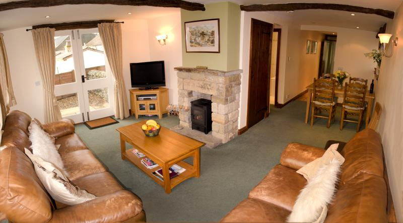 Spacious L shaped lounge/dining area with doors leading to private enclosed patio. Freeview TV &