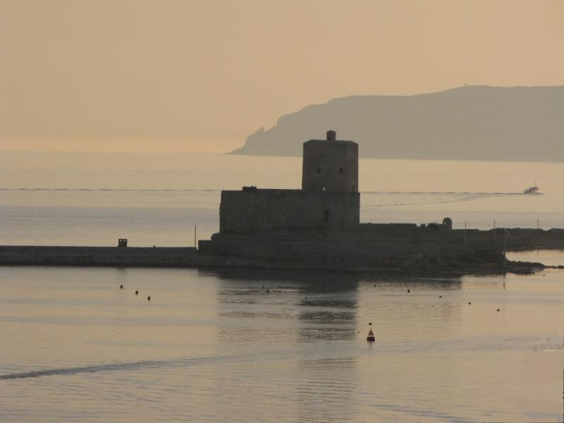 The port with the ancient fortress 'La Colombaia' - ten walk from the minute Residence