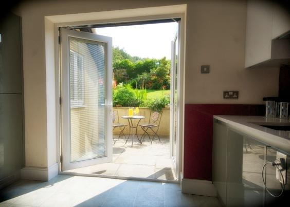 French doors from fully fitted Kitchen lead to patio.  Oven, hob, microwave, dishwasher