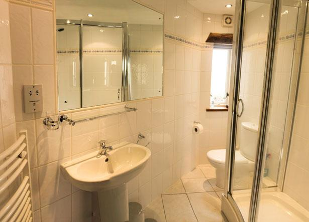 Ground floor bathroom with large shower enclosure. Luxurious underfloor heating.