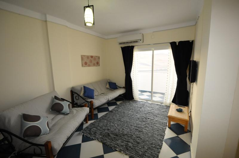 Spacious living and dining room with TV/Satellite and DVD player. Large quiet air conditioning unit.