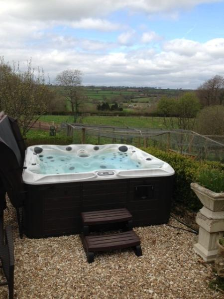 The hot tub - west facing so fantastic sunsets while relaxing with a glass of something cold!