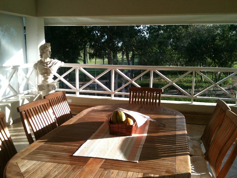 Dining area of the terrace viewing the golf course,a  fresh and shady place with awnings