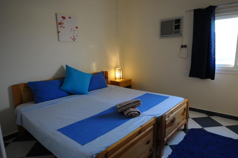 Bedroom 3 with air conditioning. Beds can be pushed together to make doubles