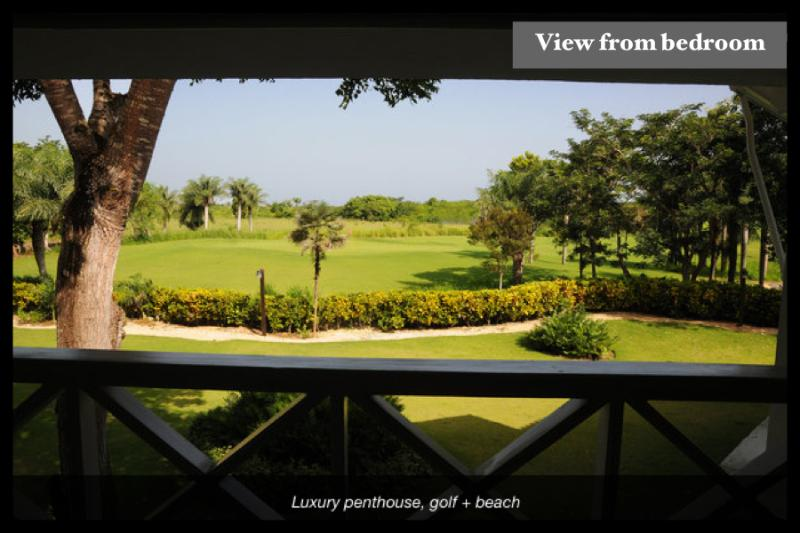 View to the golf course from the master bedroom's balcony.
