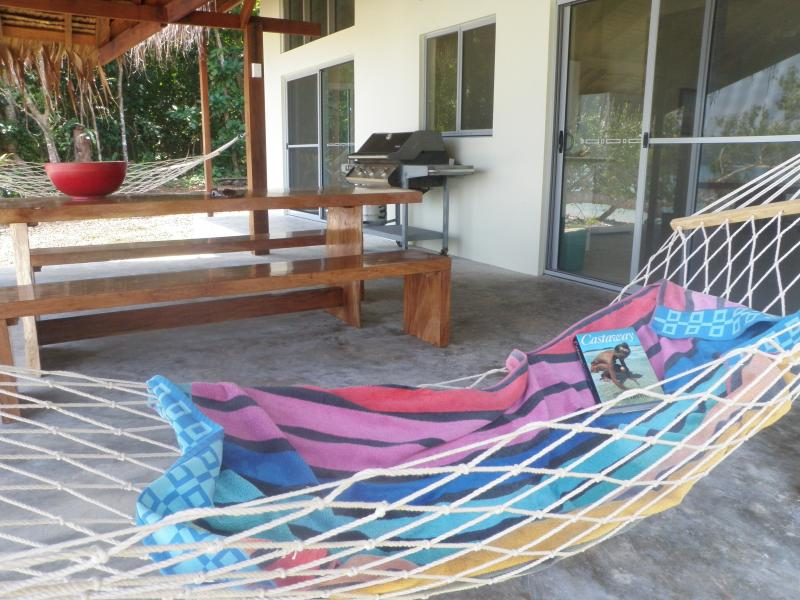Hammocks, gas BBQ and outside dining table on the deck.