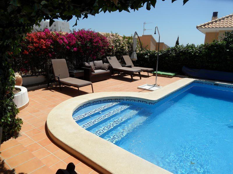 Read a good book poolside on the sofa or sunloungers