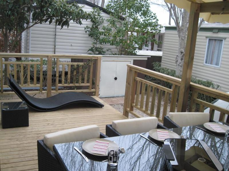 Large terrace with its garden furniture