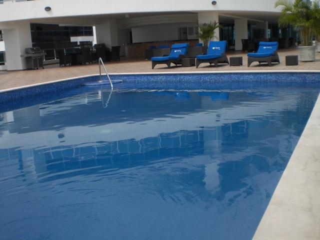 Spectacular Swimming Pool and Sunning Area:  Top quality Chairs and lounges