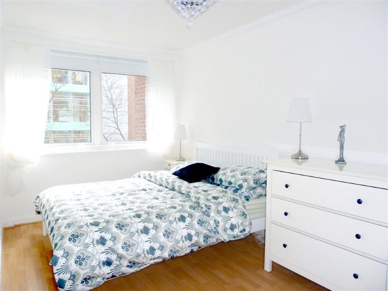 King size bed, double fitted mirrored wardrobe, drawers, large windows, black out blinds