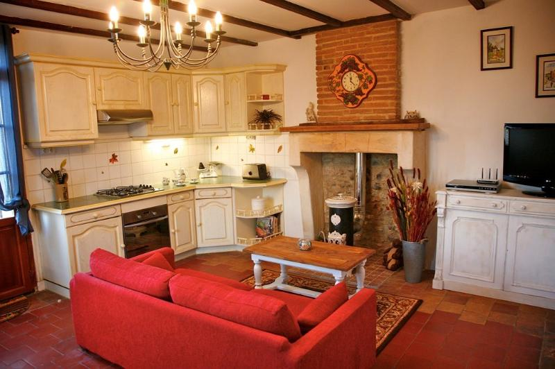 Kitchen / Lounge with traditional fitted units & original stone fireplace