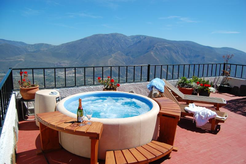 Get in the hot tub and soak in the views...