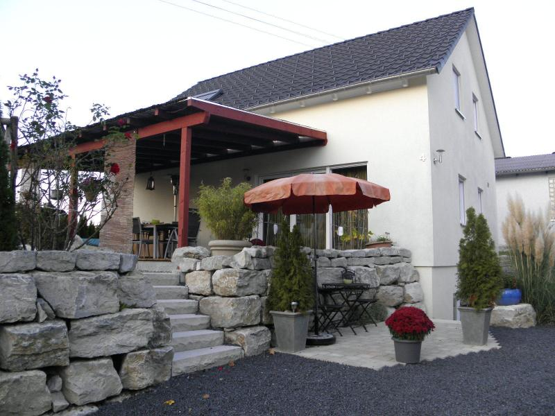 Exterior with outlet to the apartment with roofed terrace