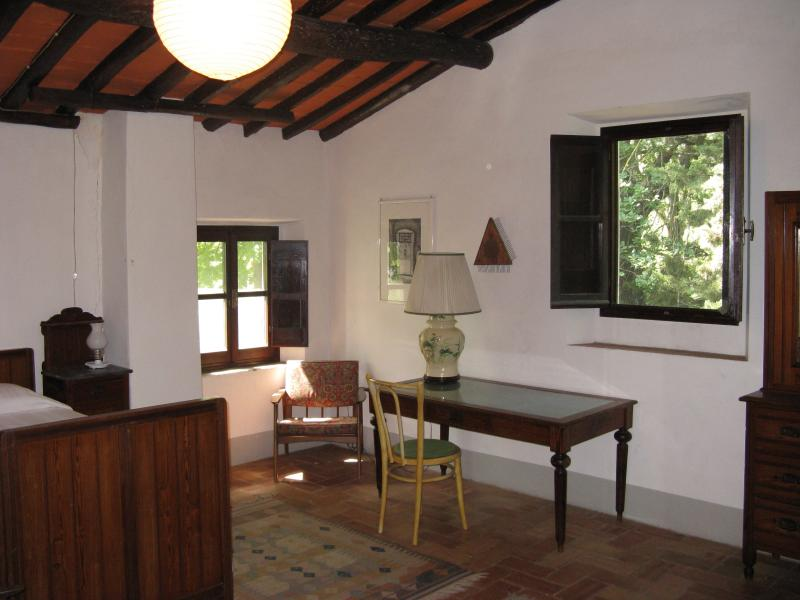 View of the bedroom with writing desk.
