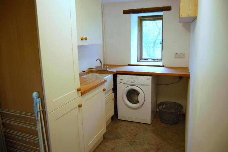 The very practical utility room is also straight off the hallway.