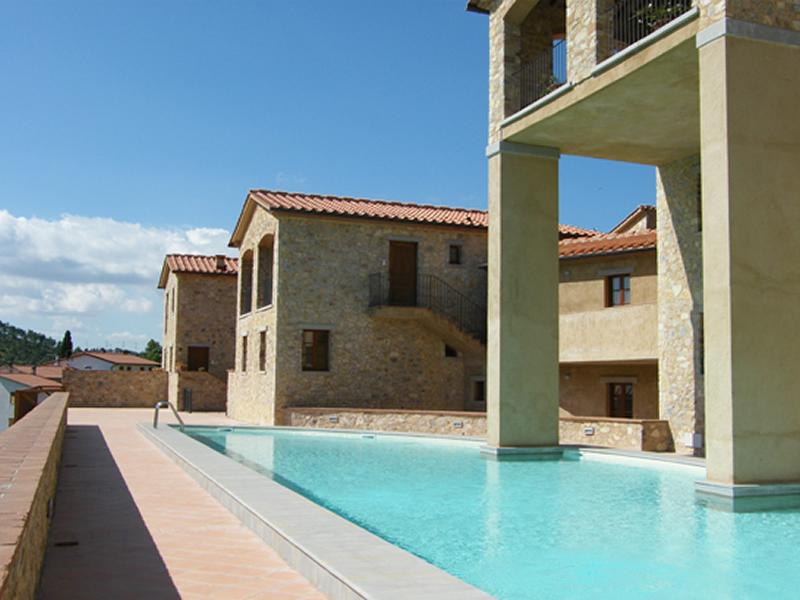 View of the main swimming pool, and a glimpse of Casa Chianti Terrace