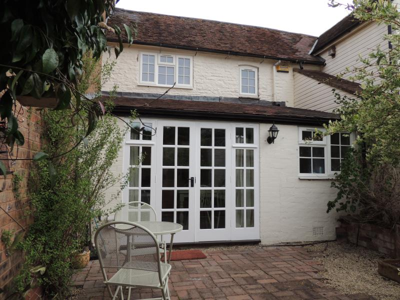 In the courtyard garden leading to french doors in the kitchen, south east facing gives sun